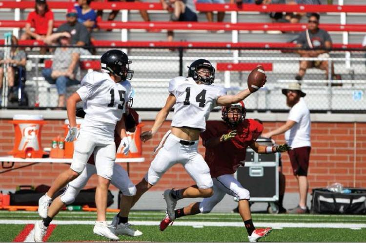 JOSH CULWELL (NO. 14) MAKES A ONE-HANDED, FINGERTIP INTERCEPTION IN SATURDAY'S SCRIMMAGE AT BORGER