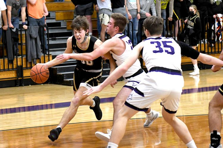 Josh Culwell (00) fights for a shot at the bucket in the Cats' win over Spearman