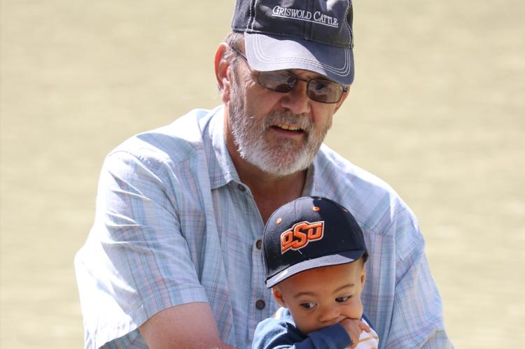 Doug is shown here with one of his grandsons, 4-year-old Kixon Douglas Benge, the son of daughter Sydni.
