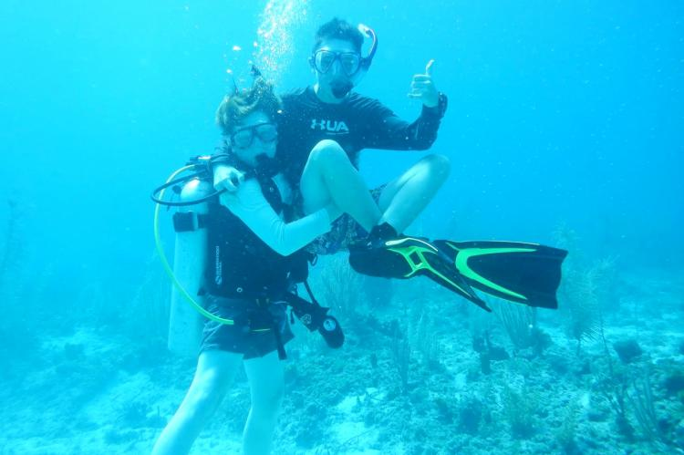 Everett free-diving with friend Harrison (wearing scuba gear) in the Bahamas