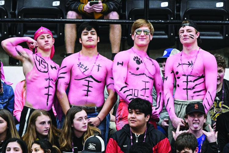 Landon Smith, Jorge Dominguez, Colton Cooper, and Hayze Hufstedler go all out in pink out for Lawana Pulliam.