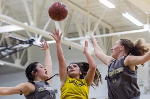 Jasmyn Moreno goes up for a basket between McLean players during Tuesday's scrimmage.