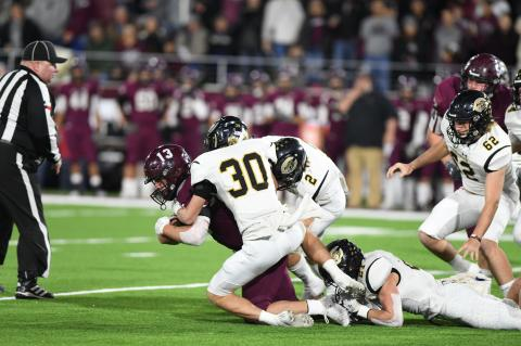 Quarterback Bryson Daily (#13) of the Abernathy Antelopes sees double trouble from Jack and Bill Koetting, who sack him for a loss as #62 Colton Risley and #21 Hayze Hufstedler (on the ground) lend a hand.