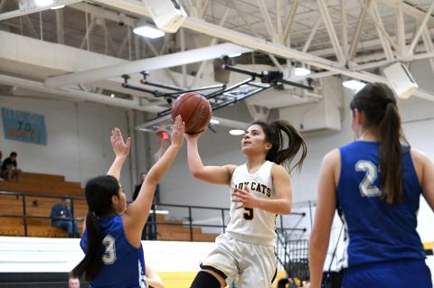 Lady Cat #5 Jasmyn Moreno catches some air for a layup in Canadian's loss to Childress on December 10.