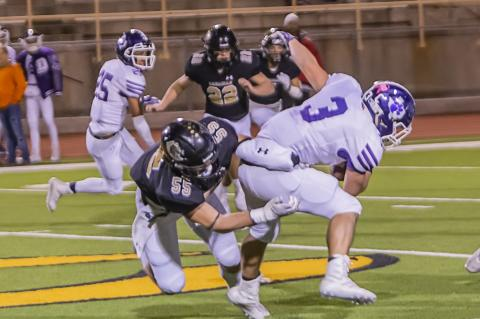 Wildcat defensive lineman Rhet Pennington (55) stops Dimmitt's Trey Aguero (3) behind the line of scrimmage.