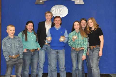 Grand and Reserve Grand Champions: (l-r): Ryan Leach, Victoria Shott, Alex Smith, Meyer Ray Ancira, Adison Walser, Mallory Poe, and Aubrie Poe. Not pictured, Twister Kelton.