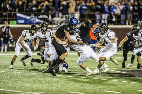 Gunter Quarterback Hut Graham (#2) was going nowhere, as the Wildcat D (#22 Jake Krehbiel, #55 Rhet Pennington, #58 Saul Escamillo, #61 Colton Cooper, #44 Stephen Pulliam and #42 Israel Guerrero) held the Tiger offense to only 300 total yards Friday night. M