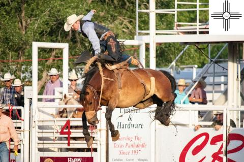 Saddle Bronc Rider Benny Proffitt puts on an aerial show