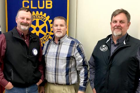 Rotary member Curt McPherson and his guests from PTCI, Travis Clark (middle), and Deblin Frances (at right)