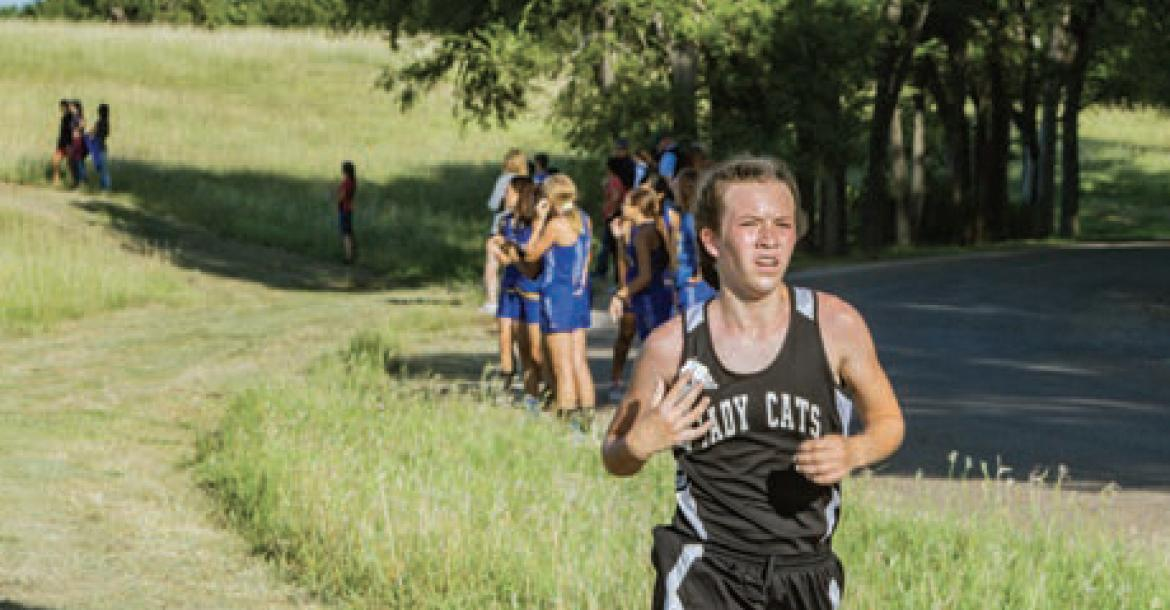 In photo above, Konner McClendon legs out lead for Canadian Middle School Cross Coun try.